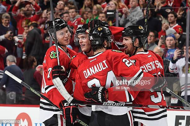 Dennis Rasmussen Jonathan Toews Phillip Danault and Erik Gustafsson of the Chicago Blackhawks celebrate after defeating the Buffalo Sabres 3 to 1...