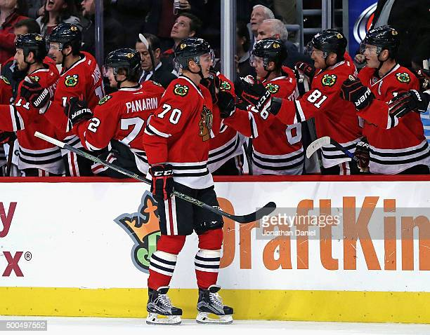 Dennis Rasmussen of the Chicago Blackhawks is congratulated by teammates after scoring his first NHL goal in the first period against the Nashville...