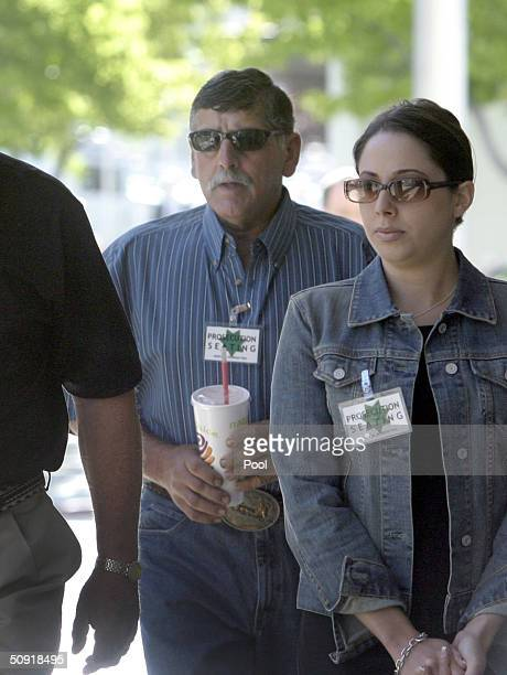 Dennis Rocha and Amy Rocha father and sister of Laci Peterson enter the San Mateo County Superior Courthouse in day two of the trial June 2 2004 in...
