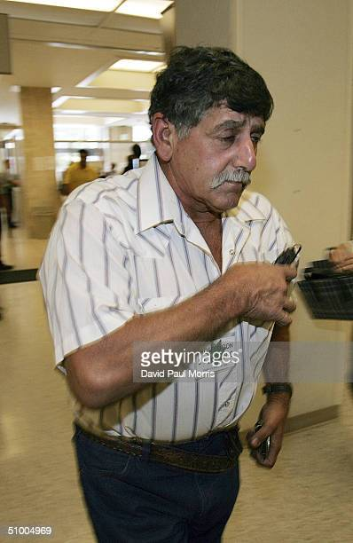 Dennis Rocha the father of Laci Peterson enters the San Mateo County Courthouse for the trial of Scott Peterson June 28 2004 in Redwood City...