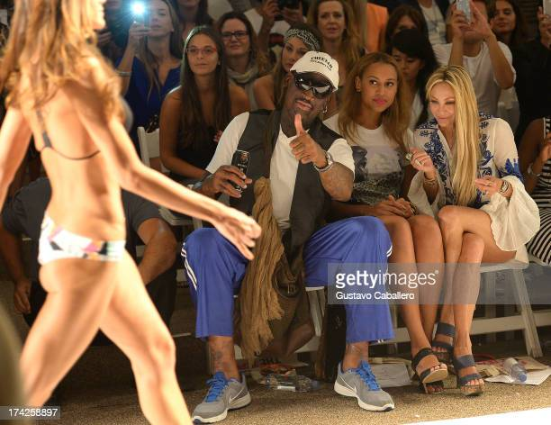 Dennis Rodman, Alexis Rodman, and Lisa Pliner attends Anna Kosturova/Beach Riot/Lolli Swim/Manglar/Indah show at Mercedes-Benz Fashion Week Swim 2014...