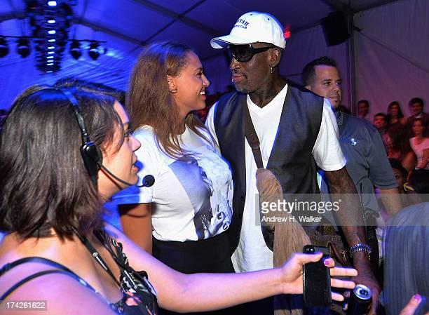 Dennis Rodman and Alexis Rodman attend the Anna Kosturova/Beach Riot/Lolli Swim/Manglar/Indah show during MercedesBenz Fashion Week Swim 2014 at the...