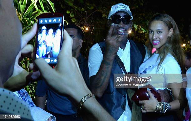 Dennis Rodman and Alexis Rodman attend the Anna Kosturova/Beach Riot/Lolli Swim/Manglar/Indah show during MercedesBenz Fashion Week Swim 2014 at the...
