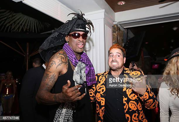 Dennis Rodman and Evan Golden attends Berman and Berman Fright Night at Blue Martini on October 23 2014 in Boca Raton Florida