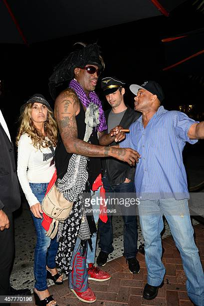 Dennis Rodman and Floyd Raglin attend Fright Night by Berman and Berman Law held at the Blue Martini hosted by Carmen Electra on October 23 2014 in...