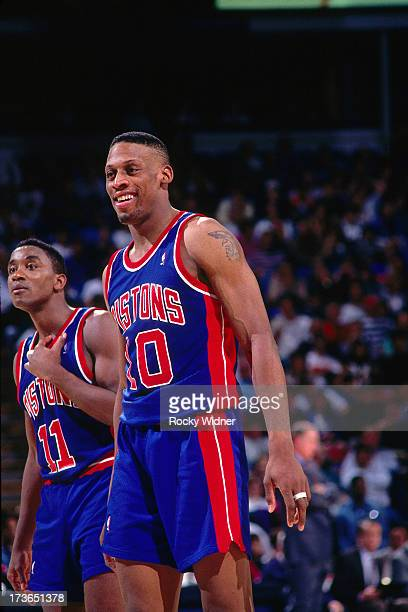 Dennis Rodman and Isiah Thomas of the Detroit Pistons look on against the Sacramento Kings during a game played on March 16 1993 at Arco Arena in...