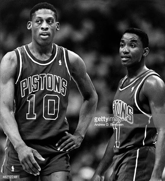 Dennis Rodman and Isiah Thomas of the Detroit Pistons look on against the Los Angeles Clippers during a game circa 1987 at the Los Angeles Memorial...