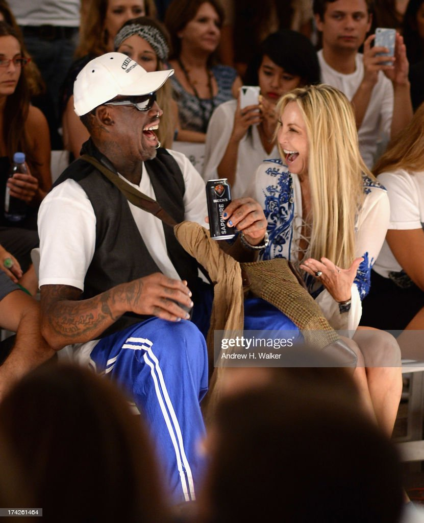 Dennis Rodman and Lisa Pliner attend the Anna Kosturova/Beach Riot/Lolli Swim/Manglar/Indah show during Mercedes-Benz Fashion Week Swim 2014 at the Raleigh on July 22, 2013 in Miami Beach, Florida.