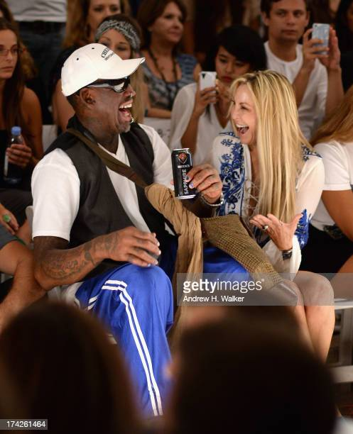Dennis Rodman and Lisa Pliner attend the Anna Kosturova/Beach Riot/Lolli Swim/Manglar/Indah show during MercedesBenz Fashion Week Swim 2014 at the...