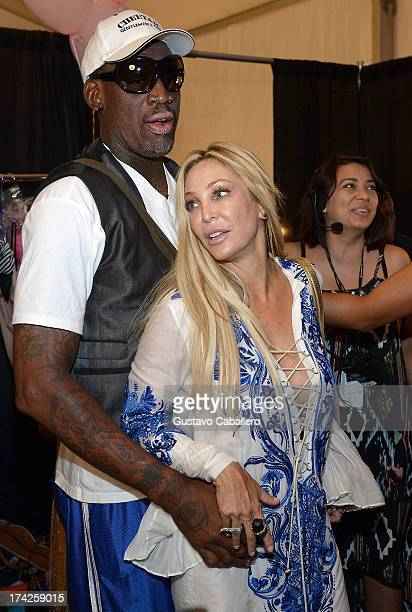 Dennis Rodman and Lisa Pliner pose backstage at the Anna Kosturova/Beach Riot/Lolli Swim/Manglar/Indah show at MercedesBenz Fashion Week Swim 2014 at...