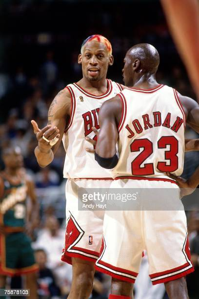 Dennis Rodman and Michael Jordan of the Chicago Bulls discuss strategy during a 1996 NBA game at the United Center in Chicago, Illinois. NOTE TO...