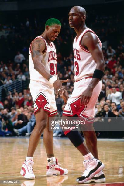 Dennis Rodman and Michael Jordan of the Chicago Bulls during the game against the New York Knicks on December 6 1995 at the United Center in Chicago...