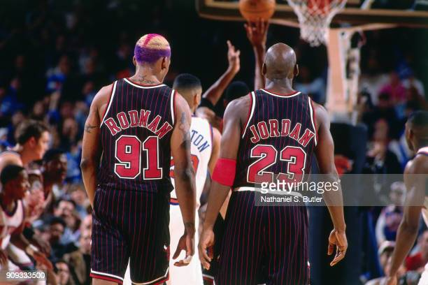 Dennis Rodman and Michael Jordan of the Chicago Bulls look on during a game played on March 9 1997 at Madison Square Garden in New York City NOTE TO...