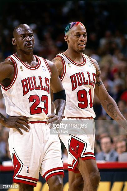 Dennis Rodman and Michael Jordan of the Chicago Bulls take the court during a 1996 NBA game at the United Center in Chicago Illinois NOTE TO USER...
