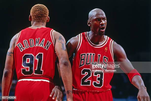 Dennis Rodman and Michael Jordan of the Chicago Bulls walk against the Los Angeles Clippers on November 25 1996 at the LA Sports Arena in Los Angeles...