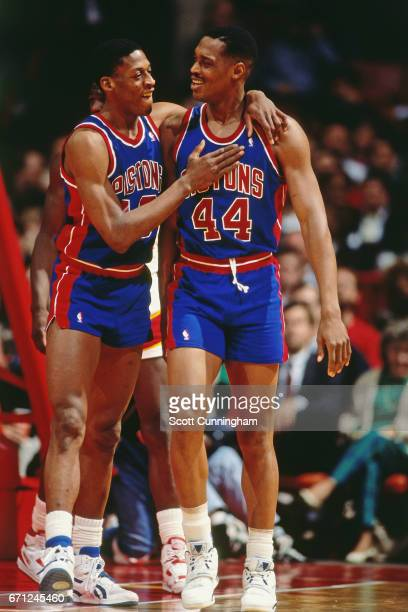 Dennis Rodman and Rick Mahorn of the Detroit Pistons hug against the Atlanta Hawks during a game played circa 1990 at the Omni in Atlanta Georgia...