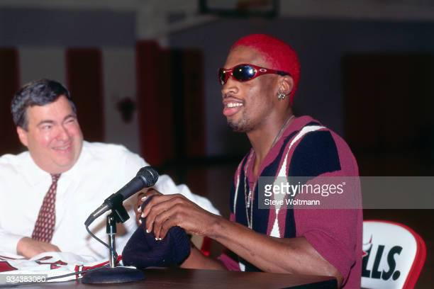 Dennis Rodman laughs during a press conference to announce he signed with the Chicago Bulls on October 5 1995 at the Berto Center in Deerfield...