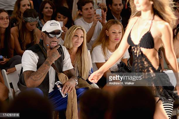 Dennis Rodman Lisa Pliner and Alexis Rodman attend the Anna Kosturova/Beach Riot/Lolli Swim/Manglar/Indah show during MercedesBenz Fashion Week Swim...