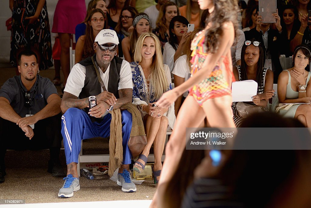 Dennis Rodman, Lisa Pliner and Alexis Rodman attend the Anna Kosturova/Beach Riot/Lolli Swim/Manglar/Indah show during Mercedes-Benz Fashion Week Swim 2014 at the Raleigh on July 22, 2013 in Miami Beach, Florida.
