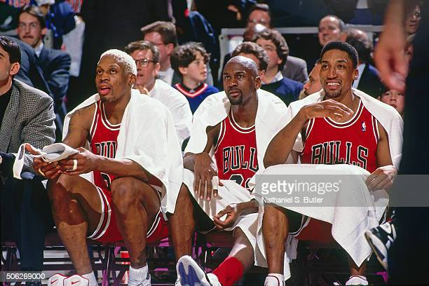 Dennis Rodman Michael Jordan and Scottie Pippen of the Chicago Bulls looks on against the New York Knicks on January 23 1996 at Madison Square Garden...