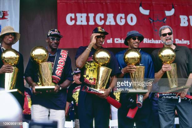 Dennis Rodman Michael Jordan Scottie Pippen Ron Harper and Head Coach Phil Jackson of the Chicago Bulls stand with the Championship Trophy at the...