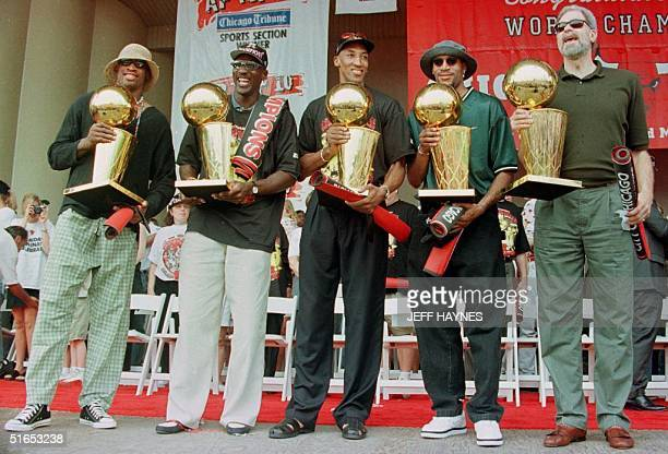 Dennis Rodman Michael Jordan Scottie Pippen Ron Harper and head coach Phil Jackson all of the Chicago Bulls hold the five Larry O'Brien NBA...