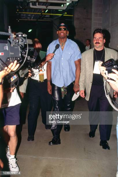Dennis Rodman of Chicago Bulls arrives before the game against the Utah Jazz on June 6 1997 at the Delta Center in Salt Lake City UT NOTE TO USER...