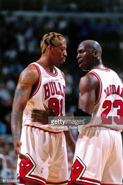 Dennis Rodman of the Chicago Bulls and Michael Jordan of the Chicago Bulls talk during a game played on May 27 1998 at the United Center in Chicago...