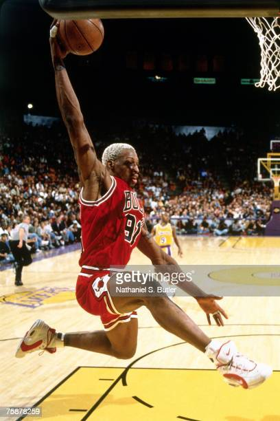 Dennis Rodman of the Chicago Bulls attempts a dunk against the Los Angeles Lakers during a 1996 NBA game at the Great Western Forum in Los Angeles...