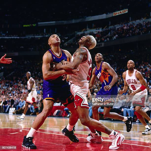 Dennis Rodman of the Chicago Bulls battles for position against Charles Barkley of the Phoenix Suns on January 28 1996 at the United Center in...