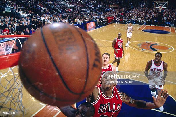 Dennis Rodman of the Chicago Bulls blocks a shot against Anthony Mason of the New York Knicks on January 23 1996 at Madison Square Garden in New York...