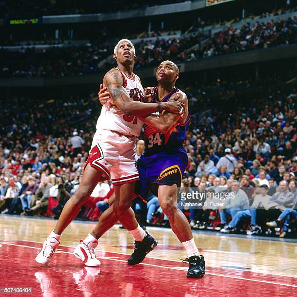 Dennis Rodman of the Chicago Bulls boxes out against Charles Barkley of the Phoenix Suns on January 28 1996 at the United Center in Chicago Ilinois...