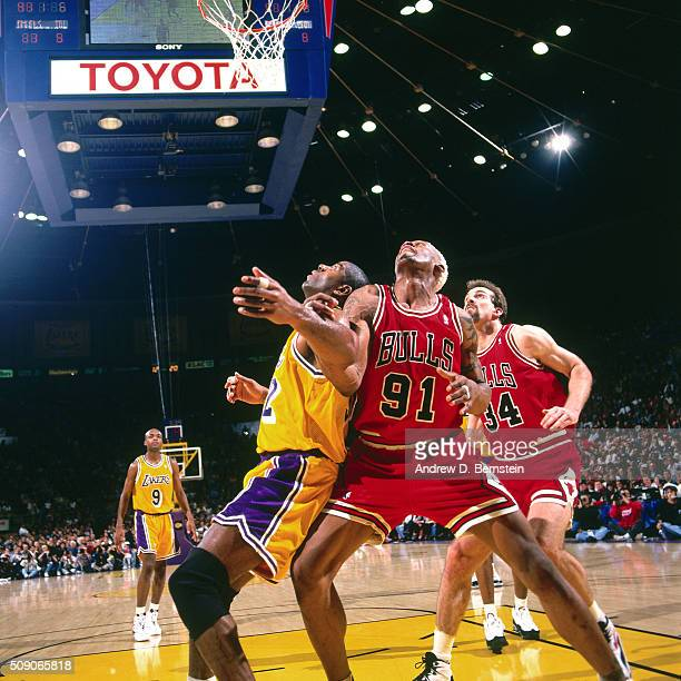 Dennis Rodman of the Chicago Bulls boxes out against the Los Angeles Lakers on February 2 1996 at the Great Western Forum in Inglewood California...