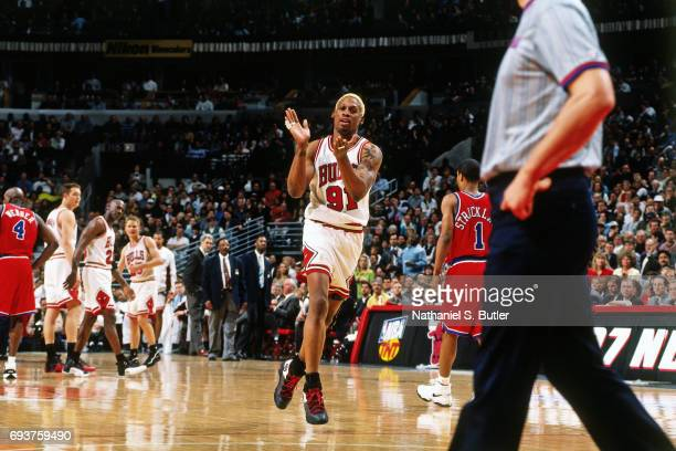Dennis Rodman of the Chicago Bulls celebrates during Game One of the First Round of the 1997 NBA Playoffs on April 25 1997 at the United Center in...