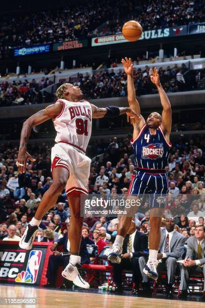 Dennis Rodman of the Chicago Bulls contests the shot by Charles Barkley of the Houston Rockets on January 18 1998 at the United Center in Chicago...
