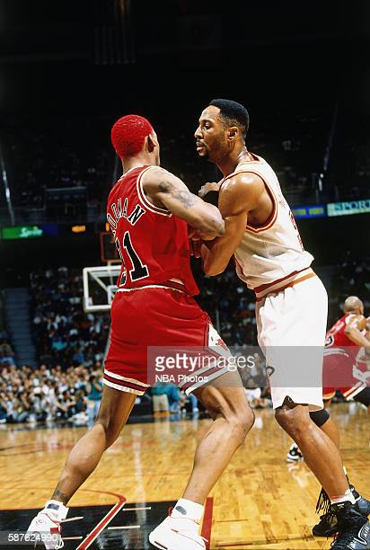 Dennis Rodman of the Chicago Bulls defends against Alonzo Mourning of the Miami Heat on April 2 1996 at Miami Arena in Miami Florida NOTE TO USER...