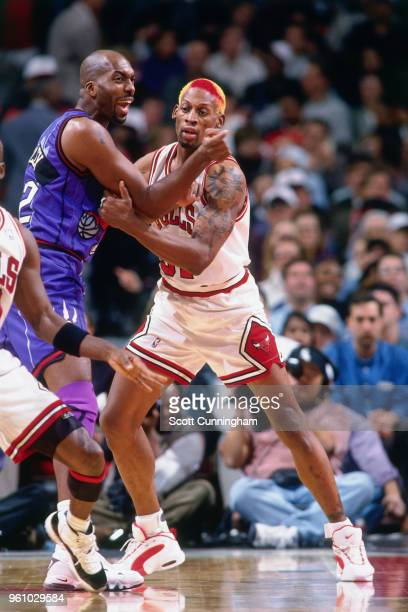 Dennis Rodman of the Chicago Bulls defends John Salley of the Toronto Raptors on November 7 1995 at the United Center in Chicago Illinois NOTE TO...