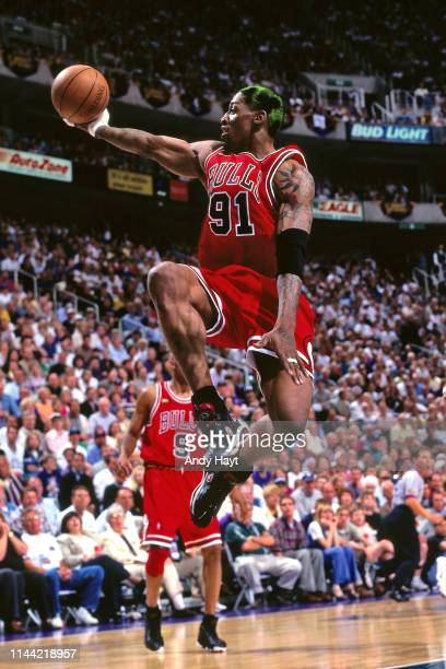 Dennis Rodman of the Chicago Bulls goes to the basket against the Utah Jazz during Game One of the 1998 NBA Finals on June 3, 1998 at the Delta...