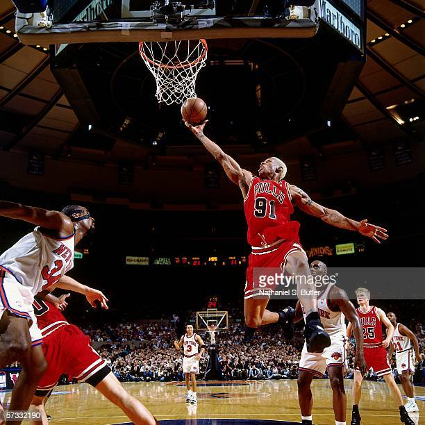 Dennis Rodman of the Chicago Bulls grabs a rebound against Charles Oakley of the New York Knicks during Game Three of the Eastern Conference...