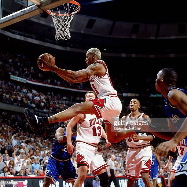 Dennis Rodman of the Chicago Bulls grabs a rebound against Nick Anderson of the Orlando Magic during Game Two of the Eastern Conference Semifinals at...