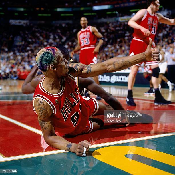 Dennis Rodman of the Chicago Bulls hustles for a loose ball against the Seattle SuperSonics in Game Three of the 1996 NBA Finals at Key Arena on June...
