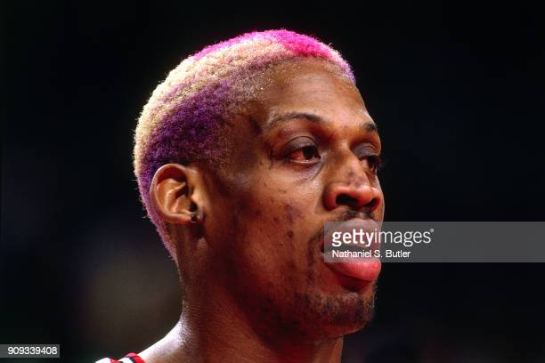 Dennis Rodman of the Chicago Bulls looks on during a game played on March 18 1997 at the United Center in Chicago Illinois NOTE TO USER User...