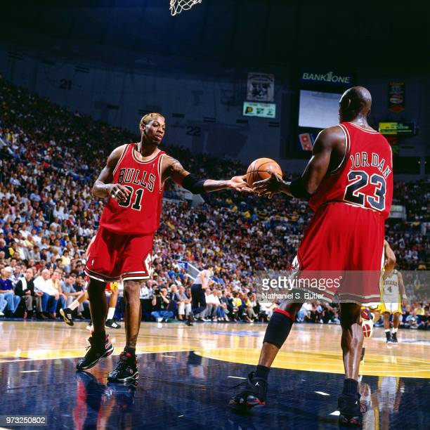 Dennis Rodman of the Chicago Bulls passes to Michael Jordan of the Chicago Bulls during a game played on May 23 1998 at the Market Square Arena in...