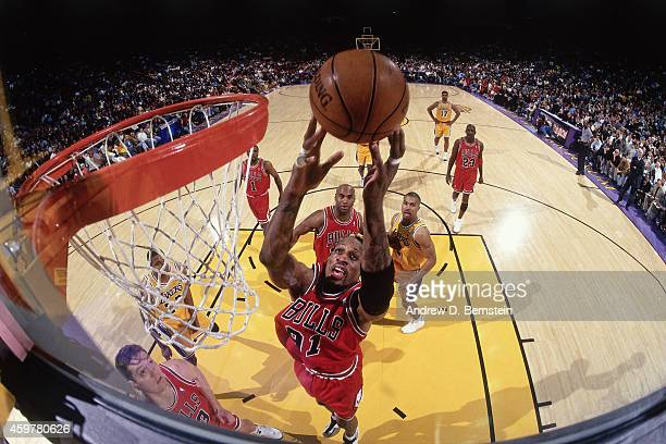 Dennis Rodman of the Chicago Bulls rebounds against of the Los Angeles Lakers on February 1 1998 at The Forum in Inglewood California NOTE TO USER...