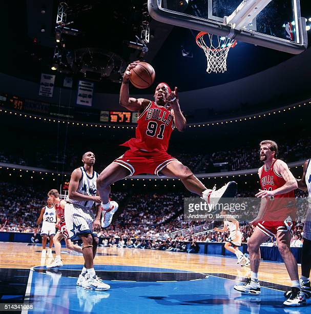 Dennis Rodman of the Chicago Bulls rebounds against the Orlando Magic on April 7 1996 at Orlando Arena in Orlando Florida NOTE TO USER User expressly...