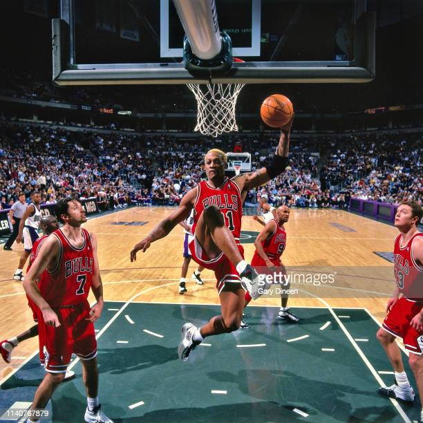 Dennis Rodman of the Chicago Bulls recovers a rebound during the game against the Milwaukee Bucks on March 29, 1998 at the BMO Harris Bradley Center...