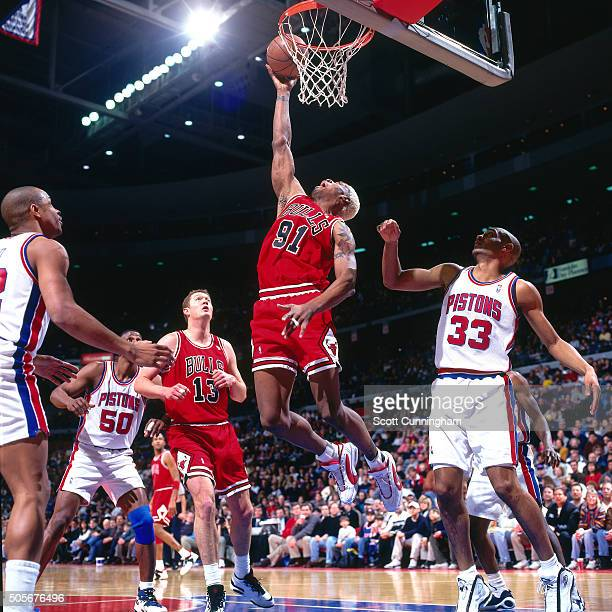 Dennis Rodman of the Chicago Bulls shoots against the Detroit Pistons on January 21 1996 at the Palace of Auburn Hills in Auburn Hills Michigan NOTE...