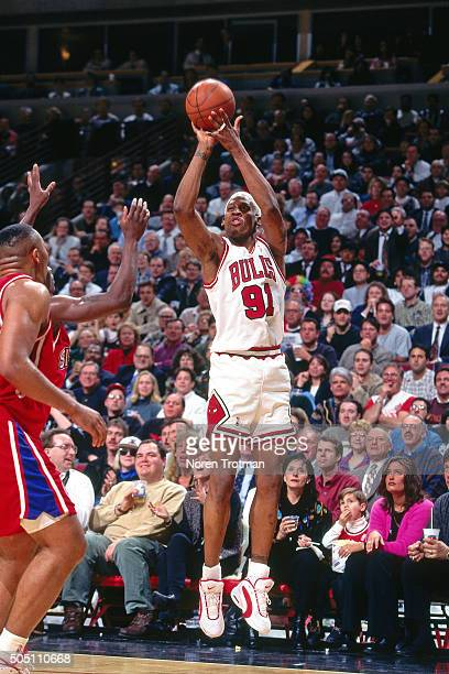 Dennis Rodman of the Chicago Bulls shoots against the Philadelphia 76ers on January 16 1996 at the United Center in Chicago Illinois The Chicago...