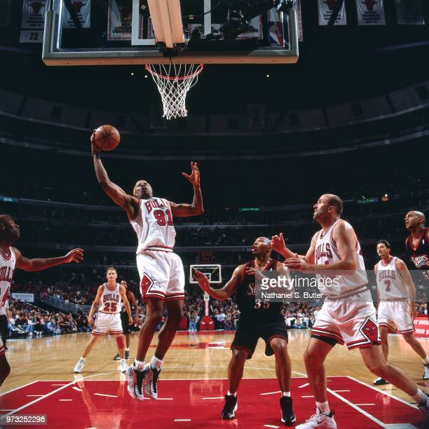 Dennis Rodman of the Chicago Bulls shoots against the Philadelphia 76ers during a game played on November 1 1997 at the First Union Arena in...