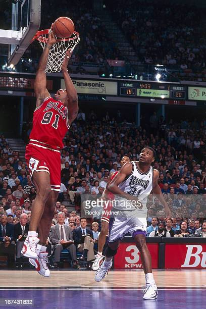 Dennis Rodman of the Chicago Bulls shoots the ball against the Sacramento Kings on February 1 1996 at Arco Arena in Sacramento California NOTE TO...